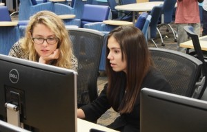 Left to right: Girls Who Code Emily Reid and Sophia Christodoulou, a junior at Archimedean Upper Conservatory.