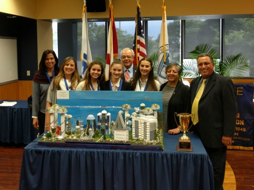 First-place winners: The team from St. Hugh Catholic School, pictured here with engineer/mentor Maria Elena Soto (far left), teacher Ana Salavarria (next to Soto), Rodrigo Rodriguez from sponsoring organization Florida Engineering Society (center, back), College of Engineering and Computing Interim Dean Ranu Jung (second from right) and competition organizer Osama Mohammed (far right)