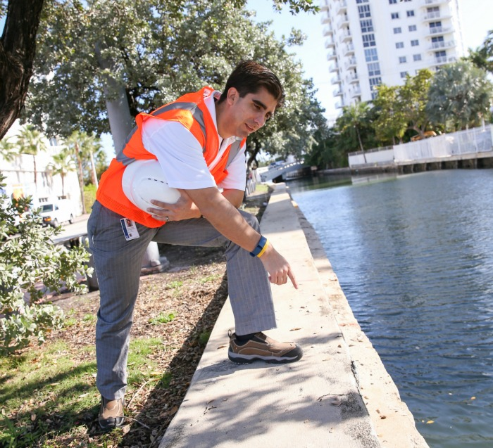 Carlos Tamayo's work as a civil engineer for the City of Miami Beach includes monitoring sea levels, flooding and groundwater intrusion.