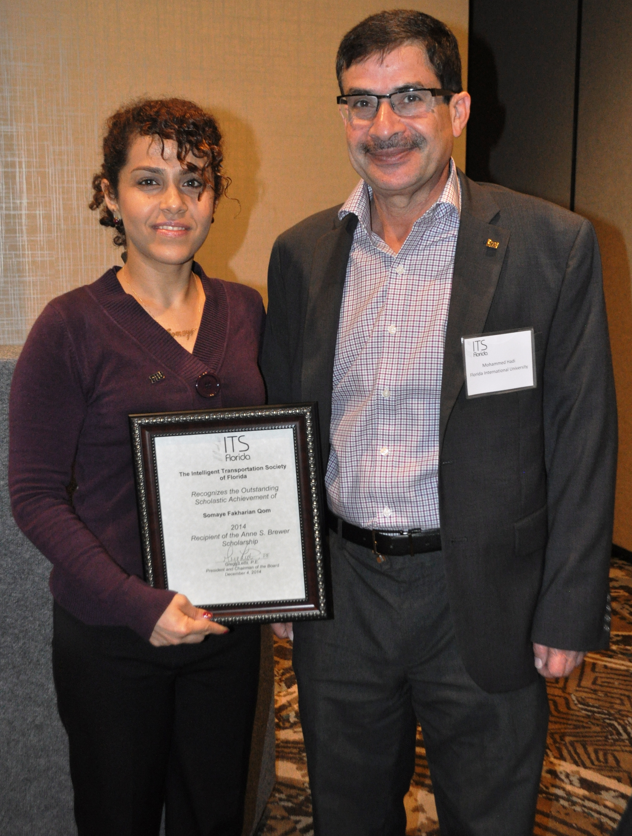 Outstanding scholastic achievement Award, Intelligent Transportation Society of Florida, December 2014 (Somaue Fakharian Qom and Dr. Mohammed Hadi)