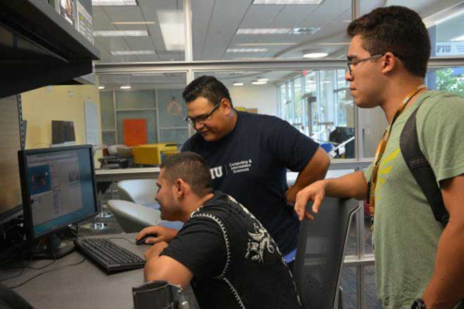 Students with developmental disabilities bond with FIU peers over computers