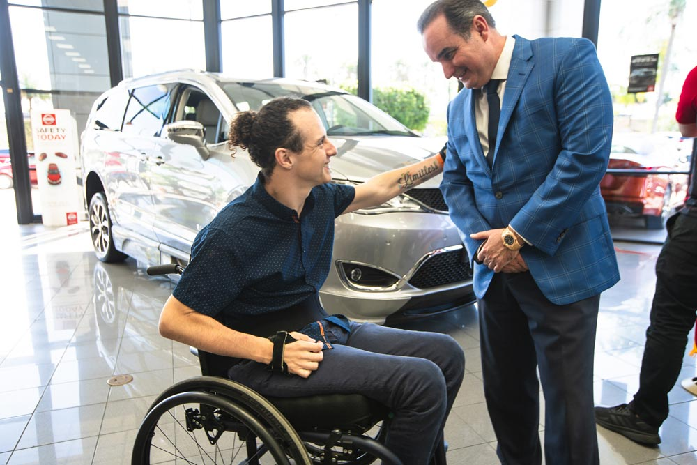 Florida Quadriplegic Who Gained Fame With Exoskelton At College Graduation Receives Keys To Wheelchair Accessible Van