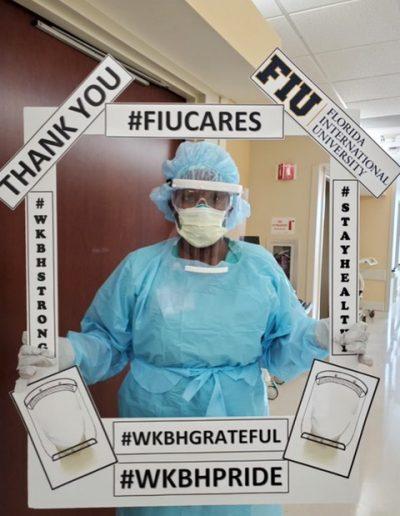 Nurse posing with FIU Border; Thanking FIU